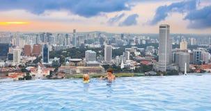 Kids swim in Singapore roof top swimming pool Stock Images