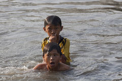 Children swimming in Saigon river Stock Photos