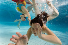 Children swimming underwater Royalty Free Stock Image