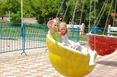 Children on a swing Stock Photos