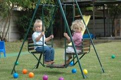 Children on swing royalty free stock photo