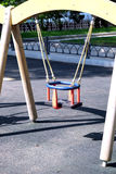 Children swing for babies in the city park Royalty Free Stock Photography