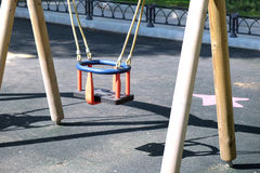 Children swing for babies in the city park Royalty Free Stock Photo
