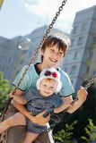 Children on a swing Stock Images