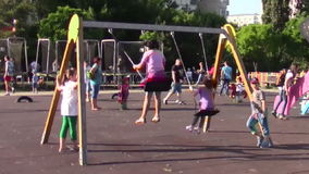 Children in the swing stock video footage