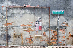 Children on the swing painted by Louis Gan at Chulia street in Georgetown, Penang Royalty Free Stock Images