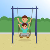 Children on Swing In the Park Stock Images