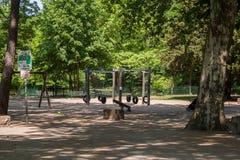 Children swing set. Image of children swing set in green park royalty free stock photo