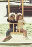 Children on swing on sunny day royalty free stock image