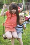 Children swinging Royalty Free Stock Photography