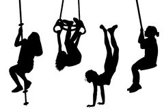 Children swinging and playing outdoor. Children silhouettes swinging and playing outdoor Royalty Free Stock Photography