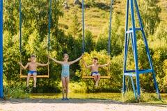 Children swinging on a swing royalty free stock photo