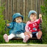 Children on the swings Stock Image