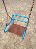 Children swings on chains Stock Image