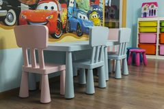 Children Table and Chairs. Kids playroom with toys and furniture Stock Image