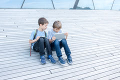 Children with tablet computers outdoor. People education learning technology leisure concept Royalty Free Stock Images