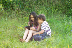 Children with a tablet stock photos