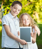 Children with tablet pc outdoors Stock Images