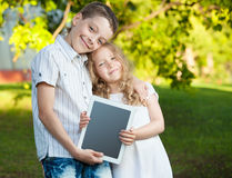Children with tablet pc outdoors Stock Image