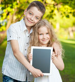 Children with tablet pc outdoors Stock Photography