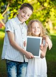 Children with tablet pc at summer Royalty Free Stock Photography