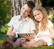 Children with tablet pc at summer Stock Image