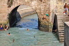 Children take a bath in the canal. Ess Stock Photography