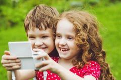 Children taking selfie with photo camera. Stock Photos