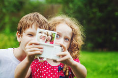 Children taking selfie with photo camera. Royalty Free Stock Photography