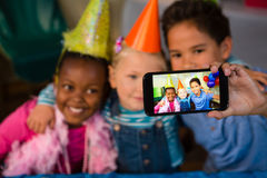 Children talking selfie at party Stock Images
