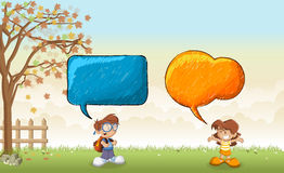 Children talking with speech bubbles Royalty Free Stock Images