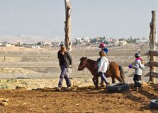 Children are taught to ride horses on a farm in the village of T. JERUSALEM, ISRAEL - DECEMBER 28, 2016: Children are taught to ride horses on a farm in the Stock Photo
