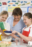 Children and teacher in class Stock Images