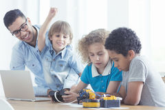 Children and teacher during classes stock photos