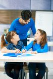 Children and teacher in classroom royalty free stock photos