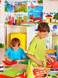 Children with teacher at classroom. Happy children  with teacher at classroom Stock Photos