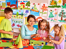 Children with teacher at classroom Stock Photography