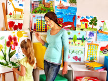 Children with teacher painting. Stock Image