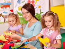 Children with teacher painting Stock Photo