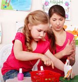 Children  with teacher  in play room. Royalty Free Stock Photo