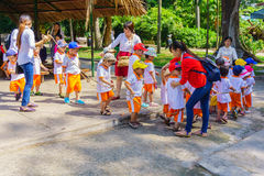 Children and teacher playing in the zoo park Royalty Free Stock Photography