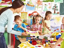 Children with teacher at school. royalty free stock image