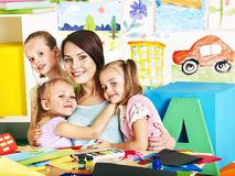 Children with teacher at school. Stock Image
