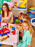 Children with teacher woman painting on paper in Royalty Free Stock Image