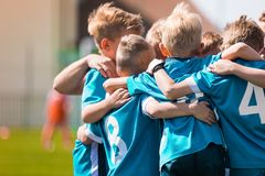 Children Team Sport. Kids Play Sports Game. Children Sporty Team United Ready to Play Game. Youth Sports For Children. Boys in Sports Jersey Red Shirts. Young stock photos