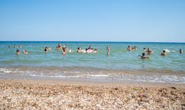 Children and teenagers swimming in the sea at summer camp. Odesa rgn. Ukraine, August 4, 2018: Children and teenagers swimming in the sea at summer camp stock images