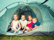 Children in a tent at summer royalty free stock photos