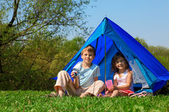 Children in tent sunny day Stock Photos