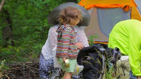 Children in the tent town sort a backpack, take stock footage