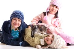 Children with their cat. Children in winter clothing playing with their cat Stock Photography